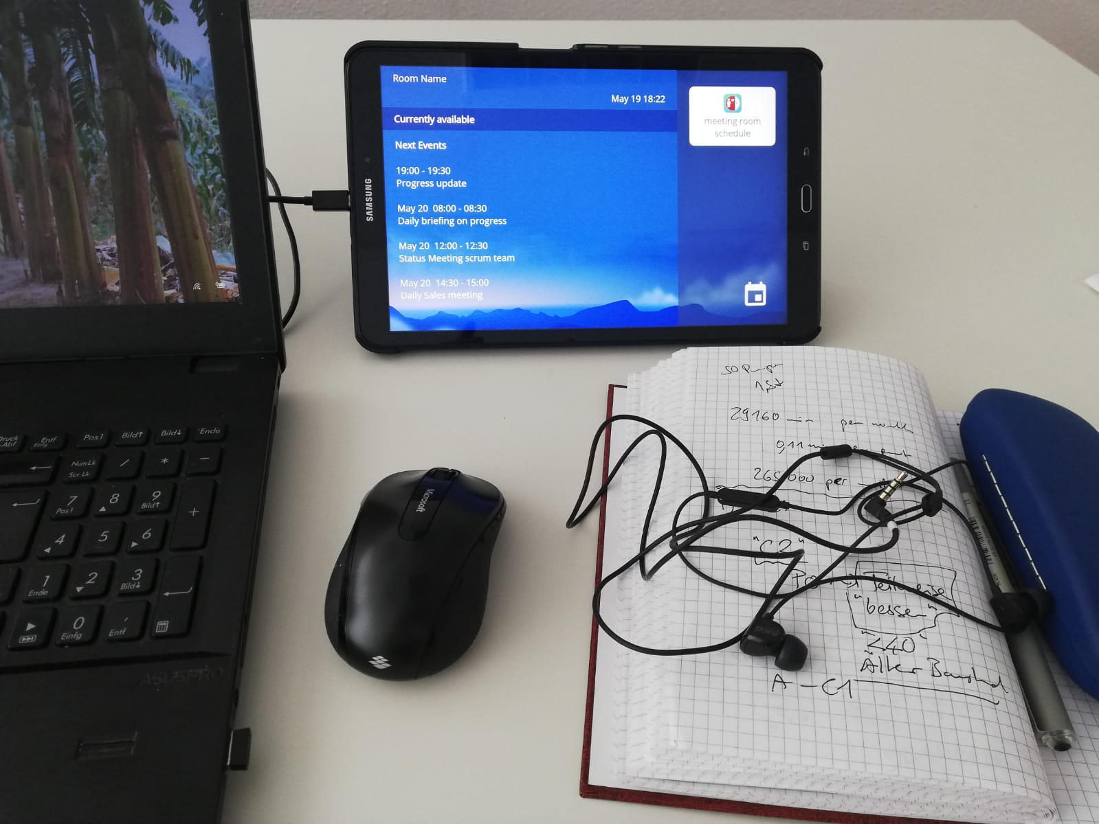 Tablet and Notebook on desk